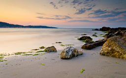 Beach with rocks at sunset Royalty Free Stock Photography