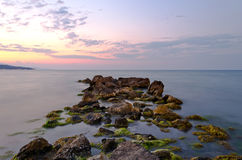 Beach rocks at sunset Royalty Free Stock Photography
