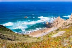 Beach among rocks. Ursa Beach near Cape Roca, Atlantic Ocean coast in Portugal royalty free stock photos