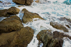 Beach Rocks and Water. Waves crashing among the rocks at the beach Royalty Free Stock Image