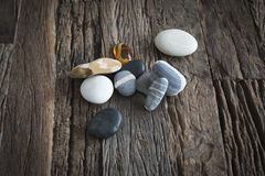 Beach rocks. On a wooden table made out of old barn woods Stock Image