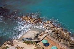 The beach on the rocky coast Stock Photo