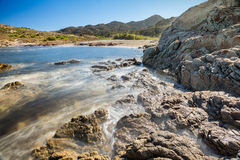 Beach and rocky coastline of north Corsica Stock Photos