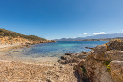 Beach and and rocky coastline at Revellata in Corsica Royalty Free Stock Photo