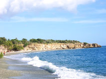 Beach in rocky landscape. A beach surrounded by rocks located at the southern coast of Cuba, in Guantanamo province Royalty Free Stock Photography