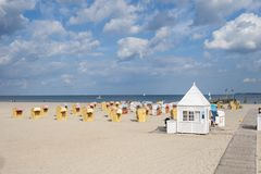 Beach with roofed wicker beach chairs in Travemünde. At the Baltic Sea Stock Images