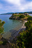Beach with ruins of old roman fortress in background, Sithonia, Greece Royalty Free Stock Photo