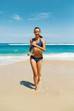 Beach Run. Fitness Woman In Bikini Running In Summer Stock Photo