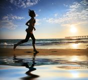 Beach running Stock Images