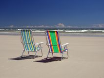 Beach's chairs. Chairs colored in the beach Stock Images