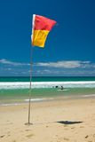 Beach Safety. Red and Yellow Lifeguard flag on an Australian Beach Stock Photo