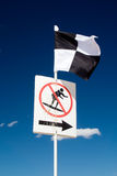 Beach Safety Flag. Black and white chequered beach safety flag, indicating an area zoned by lifeguards for use of watercraft Royalty Free Stock Photo