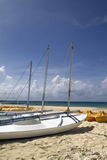 Beach Sail Boat. A personal sail boat on the beach by the ocean Royalty Free Stock Image
