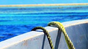 Beach. Sailing boat in the ocean Stock Photo