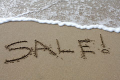 Beach Sale. Words written in the sand on a beach Stock Photo