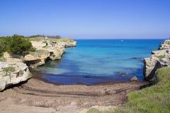 Beach in Salento, Apulia, Italy. Beach between the cliffs in Salento, Apulia, Italy Stock Images