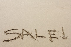 Beach Sales. Words written in the sand on beach Royalty Free Stock Images