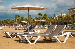 The beach in Salou. Beach with deckchairs and umbrellas in Salou in Spain Royalty Free Stock Images