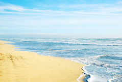 Beach in San Francisco California. With waves coming to the sand and blue sky background Stock Photos