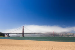 On beach San Francisco looking at the Golden Gate Bridge. On the beach in San Francisco looking out at the Golden Gate Bridge on a sunny day Stock Images