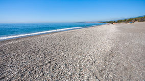 Beach San Marco on Ionian Sea coast in Sicily. Travel to Italy - black pebble and sand beach San Marco on Ionian Sea coast in Sicily Royalty Free Stock Photography