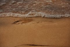 Beach sand background. Beach sand getting wet by the sea water Royalty Free Stock Photography