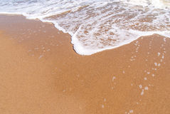 Beach  sand background. Wave and sand Stock Photography