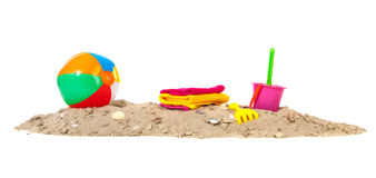 Beach sand with ball and toys. Beach sand with shells, ball, toys and towels Royalty Free Stock Images