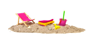 Beach sand with chair and toys. Beach sand with shells chair, toys and towels Royalty Free Stock Images
