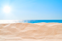 On the Beach - sand dune in front of beautiful azure sea Royalty Free Stock Photography