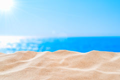 On the Beach - sand dune in front of beautiful azure sea on a sunny day Royalty Free Stock Photography