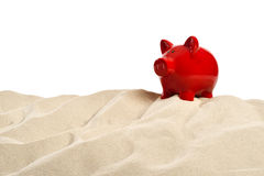 On the Beach - Sand dune with a red  piggy bank in front of a white background - clipping path included Stock Images
