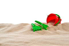 On the Beach - Sand dune with sand toys in front of a white background - clipping path included Stock Image