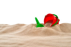 On the Beach - Sand dune with sand toys in front of a white background - clipping path included Royalty Free Stock Photos