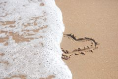 Beach sand with and Heart Shape Royalty Free Stock Photo