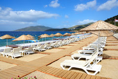The beach with sand at luxury hotel Stock Images