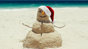 A beach sand man sculpture wishes a Merry Christmas Royalty Free Stock Photography