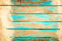 Beach sand on old wood plank in blue sea paint Stock Images