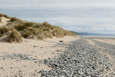 Beach with sand, pebbles and dunes Royalty Free Stock Images