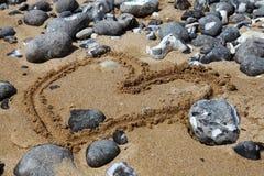 Beach with sand and pebbles, England Stock Photos