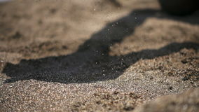 Beach sand poured out of the hands stock footage