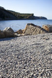 Beach with sand, round stones, selective focus Stock Image