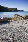 Beach with sand, round stones, selective focus Stock Photography
