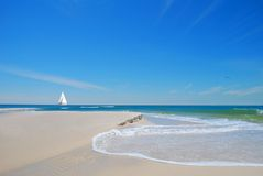 Beach Sand and Sailboat Stock Image