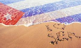 Beach sand, sea and flag Cuba. I love Cuba concept royalty free stock images