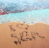 Beach sand, sea and flag Indonesia. I love Indonesia concept.  stock photos