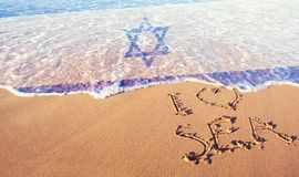 Beach sand, sea and flag Israel. I love Israel concept royalty free stock photo