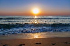 Beach sand sea sky sun sunset Royalty Free Stock Photos