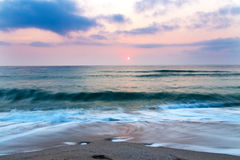 Beach sand sea sky sun sunset Royalty Free Stock Photos