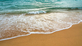 Beach sand and sea water Stock Image